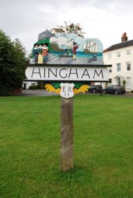 An image of Hingham Village sign, which depicts parishoners about to set sail for the New World