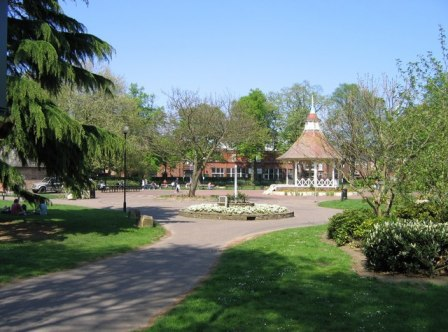 An image of Chapelfield Gardens in Norwich, with the bandstand in view