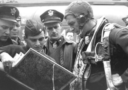 An image of James Stewart discussing a mission