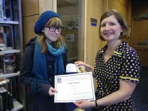 An image of Lucy collecting her prize